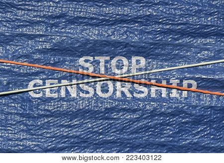 Text Stop Censorship written on blue background with rope over it