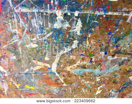 Artist painting of multicoloured paints splashes whites and blues