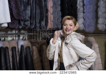 Purchase, shopping, business, moneybags. Fashion and beauty, winter, fur. Shopping, seller, fashion model, customer. Woman in fur coat, shopaholic. sensual woman in fur, luxury, moneybags, business.