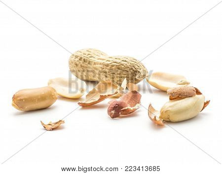 Peanuts stack isolated on white background (shelled in husk, unshelled, separated husk pieces)