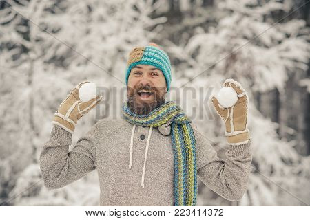 Hipster In Thermal Jacket, Hat, Scarf, Beard Warm In Winter
