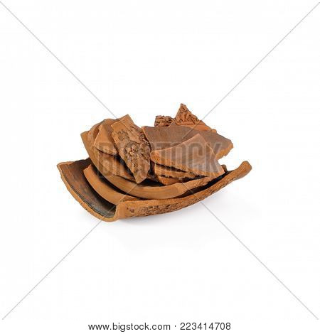 Pile of brown ceramic shards isolated on white background