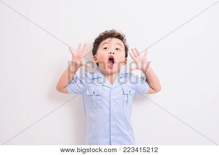 Shot of a shouting little asian boy