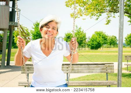 woman in her 50s having fun on the playground