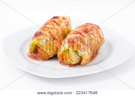 delicious stuffed cabbage rolls over white background