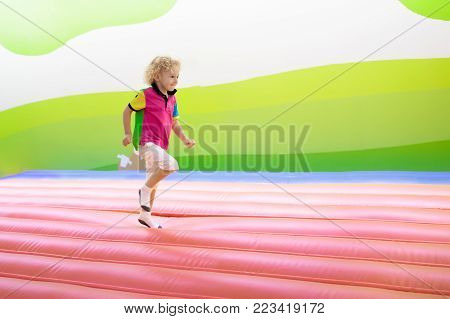 Child Jumping On Playground Trampoline. Kids Jump.