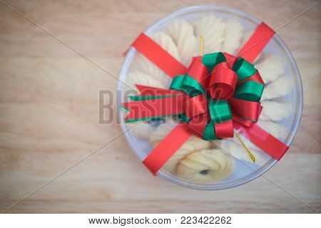 Cookies in transparent box with red ribbon and red and green bow