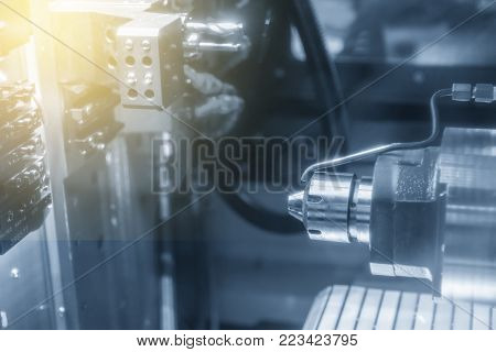 CNC lathe machine (Turning machine) cutting the metal part. High technology manufacturing process.