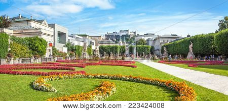 Panoramic view of famous Mirabell Gardens with the old historic Fortress Hohensalzburg in the background in Salzburg, Austria