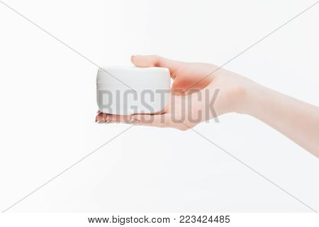 cropped shot of woman holding jar of anti-wrinkle cream isolated on white
