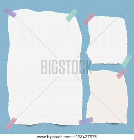 Pieces of torn white note, notebook paper stuck with sticky tape on blue squared background.