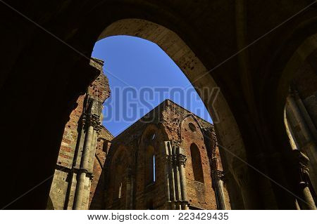 An arch of a roofless church in Italy