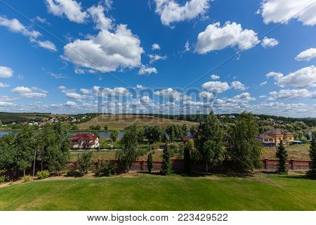 Countryside landscape against a background of meadows, forests and sky. Countryside landscape.