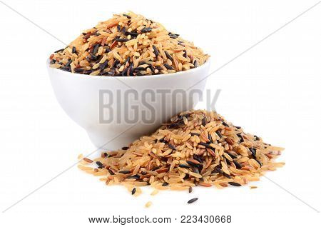 Bowl with brown wild rice isolated on white background