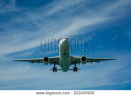 Passenger airplane in the clouds before landing
