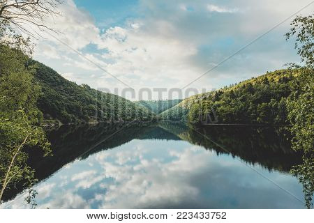 Bird's Eye View Of Lake And Forest Taken By Drone