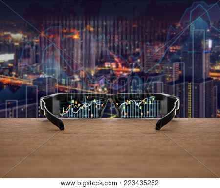 Stock exchange market trading graph focused in glasses lenses on the wooden over the abstract photo blurred of trading graph background, business technology trading concept, 3D illustration