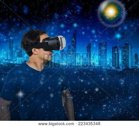 Double exposure of Asian man wearing virtual reality showing the building cityscape over star with the earth and cityscape background,Elements of this image furnished by NASA, VR concept
