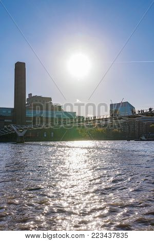 LONDON, UNITED KINGDOM - NOVEMBER 06: View of the Tate Modern museum and the Millenium Bridge along the River Thames on November 06, 2017 in London