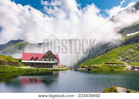 Fagaras mountains, Romania - Jun 26, 2017: rising clouds on lake Balea. beautiful summer landscape of popular tourist attraction. one of the most visited locations near the Tranfagarasan road