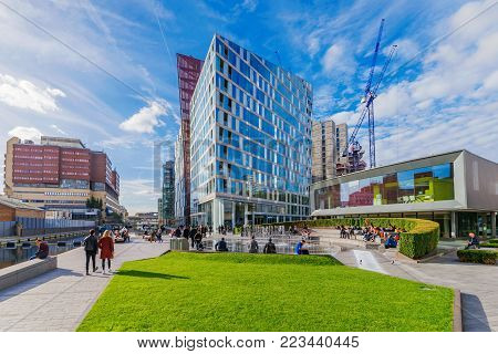 LONDON, UNITED KINGDOM - OCTOBER 30: Paddington Basin riverside park and contemporary office buildings on October 30, 2017 in London