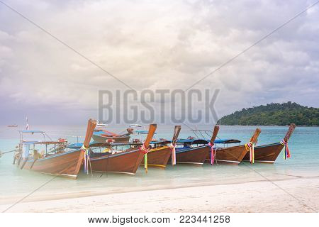 The Many Longtail Boat On Clear Blue Sea With Soft Light, Vintage Tone