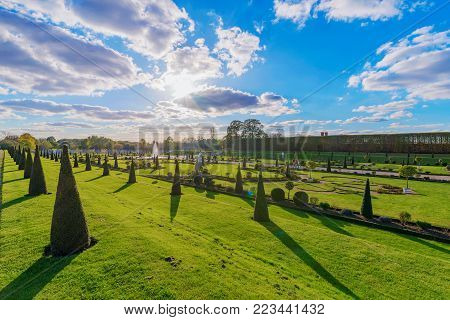 LONDON, UNITED KINGDOM - OCTOBER 27: Scenery and gardens of Hampton Court Palace, a historic palace in the Richmond area on October 27, 2017 in London