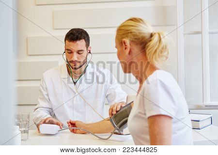 Blood pressure monitoring at office of doctor in medical clinic