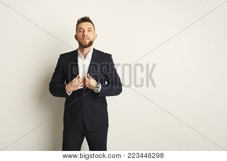 Handsome young caucasian businessman posing in studio on white isolated background. Confident serious man in formal clothes, copy space