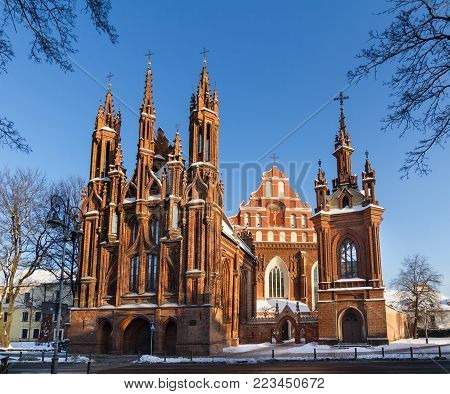 Front view of the red brick gothic St. Anne's church and Bernardine church in the Old Town of Vilnius, Lithuania on a winter day.