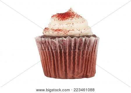 Real close up on a delicious red velvet birthday cupcake, isolated on white background.
