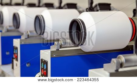 Automated Yarn Spinning Machines. Modern Textile Plant.  Row Of Automated Machines For Yarn Manufact