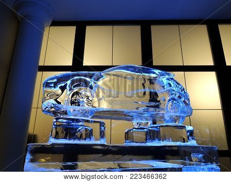 Scale Model Of Vehicle Made From Ice On The Transparent Pedestal
