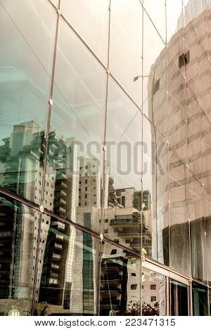 Modern city building window glass refections. Contemporary commercial exterior.