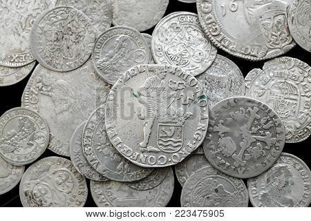 trove of ancient medieval coins silver background