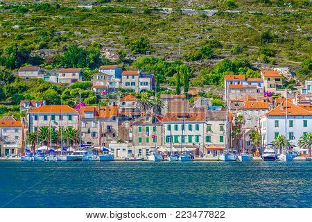 Seafront scenery in mediterranean island Vis, croatian travel summer places. poster