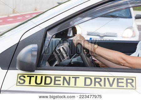 Learning to drive a car. Driving school.