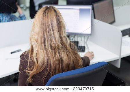 Data entry clerk. Female computer operator at work.