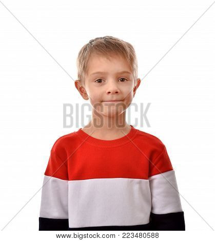 Portrait of a boy. A cheerful boy. Isolated boy. Good mood.