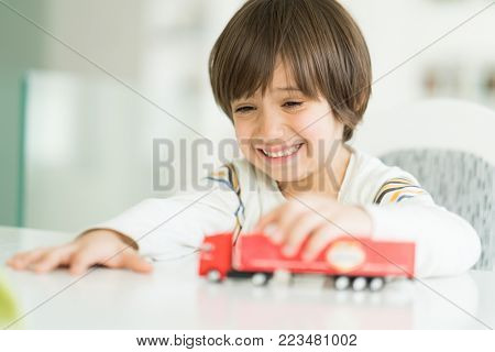 Boy playing with no name truck toy