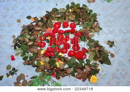 Petals of red roses in the form of heart
