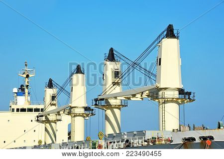 Cargo cranes on bulk carrier ship deck