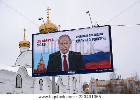 Yoshkar-Ola, Russia - January 14, 2018 Epre-election poster in Russia on a billboard featuring Vladimir Putin with the slogan A strong president is a strong Russia. The elections will be held in March 2018
