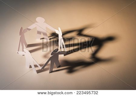 closed joining of five paper figure in hand down posture on light background. in concept of business, cooperation and teamwork.