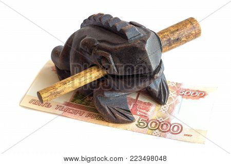 Wooden money frog and banknote in nominal value of five thousand rubles,  a souvenir. Isolated.