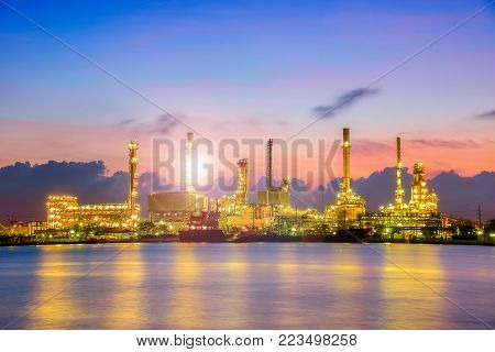 Oil And Gas Industry - Refinery At Twilight - Factory - Petrochemical Plantwith Reflection Over The