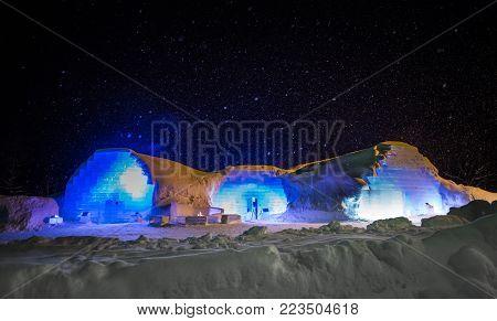 Hokkaido,Japan - January 19,2018 : night photo of ice hotel , bar and restaurant at resort hokkaido ,japan   in winter season with snow fall