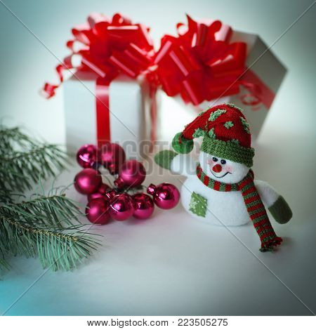 snowman , Christmas balls and gifts .isolated on white background .photo with copy space