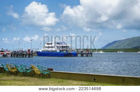 Cairns foreshore Queensland Australia. Overlooking Trinity inlet with colorful deck chairs