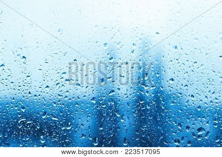 water drops on blue background / Drops of rain on glass , rain drops on clear window / Blue Abstract Water Drops Background / water drops on glass surface as background